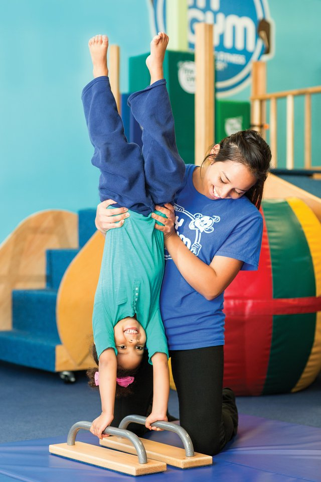 imagesevents27582P2040-2-4-Girl-with-Teacher-on-Low-Bars-jpg.jpe
