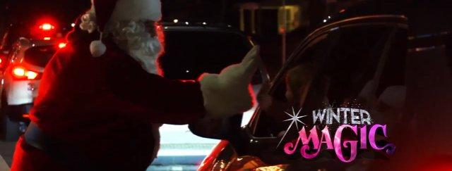 Winter Magic - Santa scans tickets at Covid-safe Christmas event.jpg